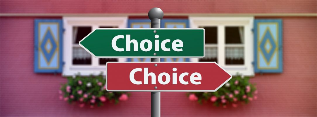 "Two signs with the word ""Choice"" pointing in opposite directions, one green and one red."