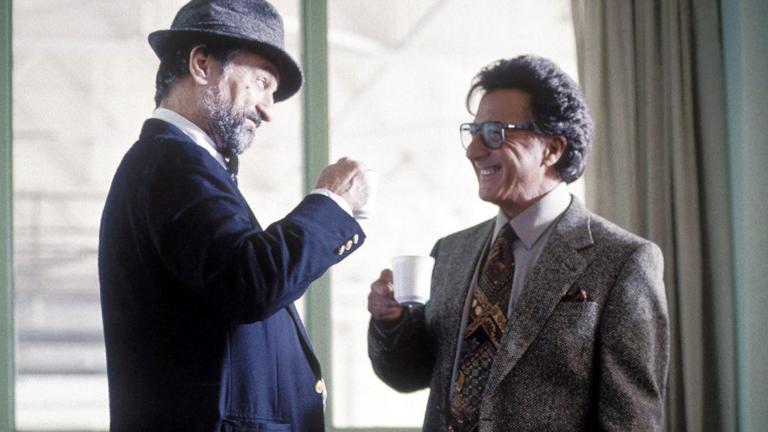 Screen cap from Wag the Dog, with Dustin Hoffman and Robert de Niro drinking coffee together.