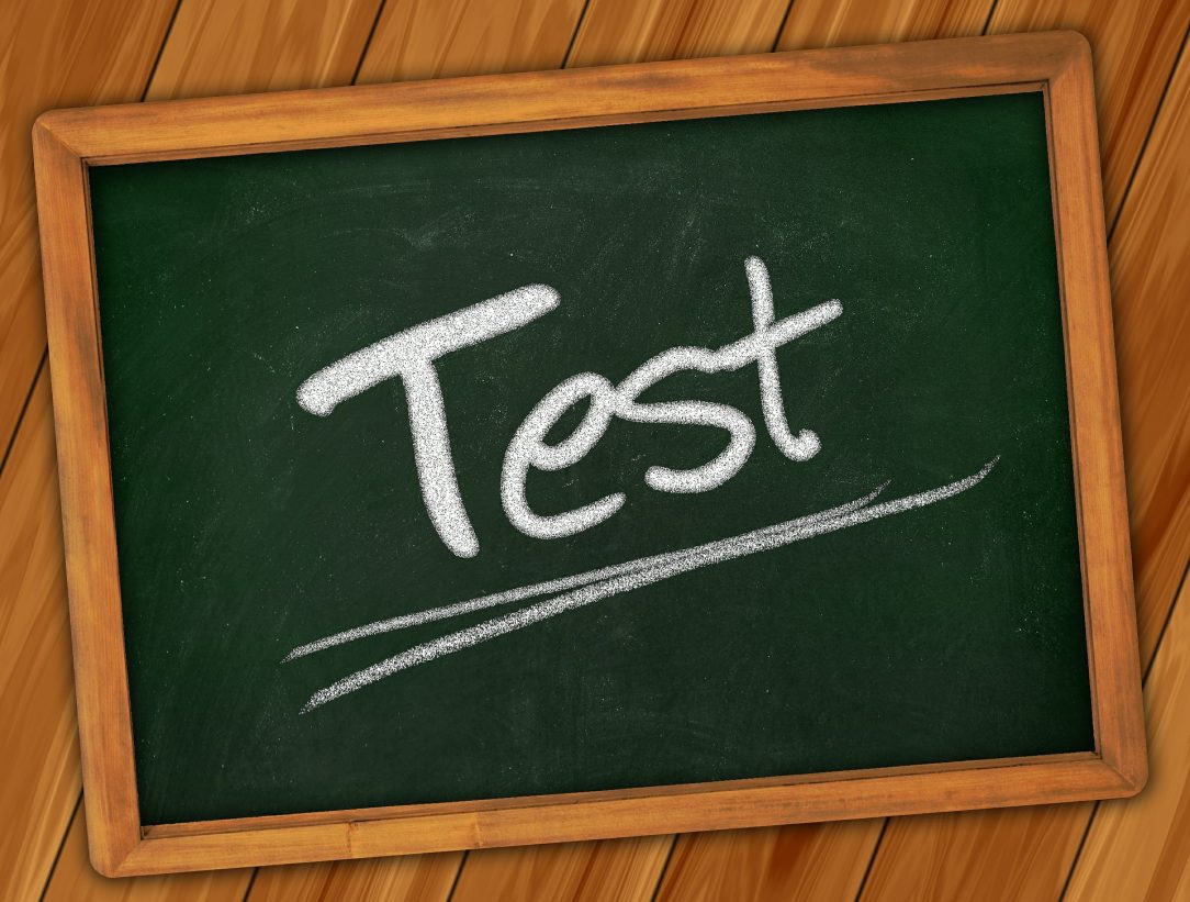 """Drawing of a chalkboard with the word """"Test"""" written in chalk and underlined."""