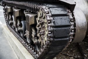 Close up picture of the treads on a tank.