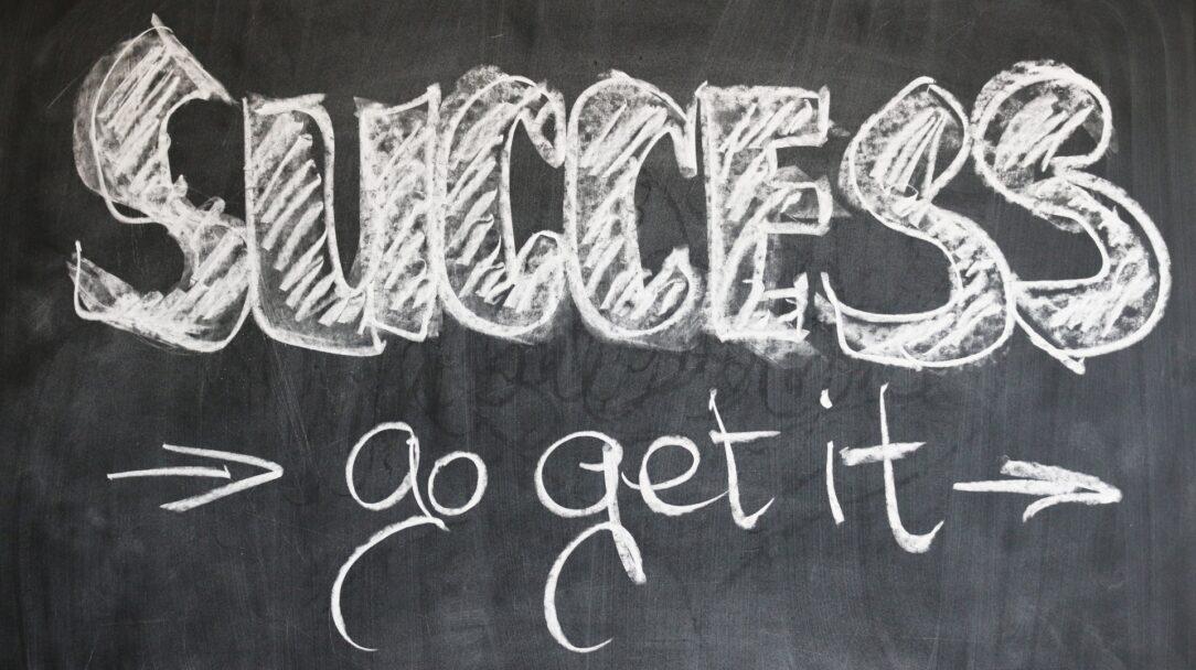 """Blackboard with the phrase, """"Success, Go Get It!"""" written on it."""