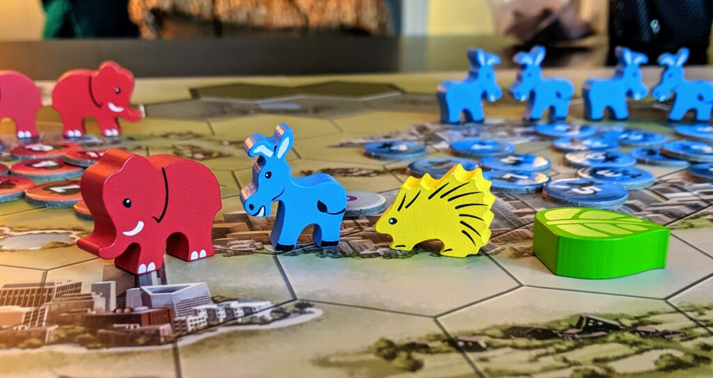 Close up view of the four game pieces from Mapmaker: the Gerrymanderin game.