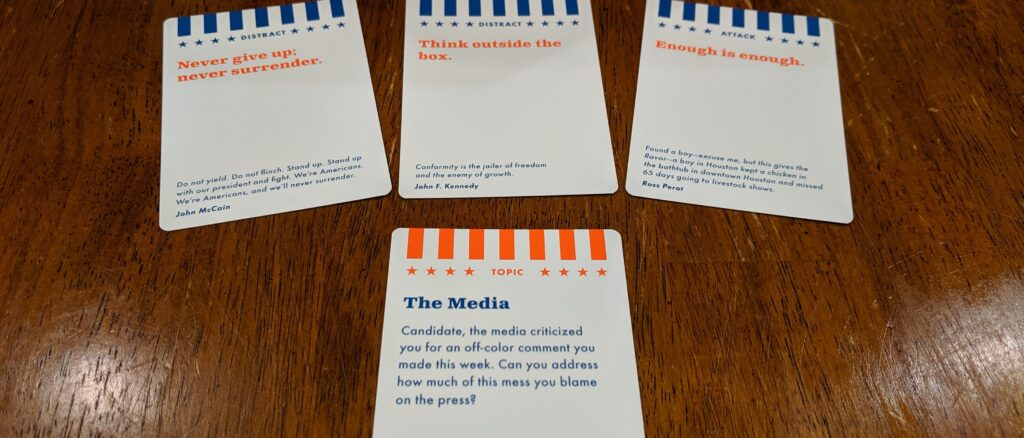 "A sample round of play from The Contender. The topic card, ""The Media,"" followed by ""Never give up; never surrender,"" ""Think outside the box,"" and ""Enough is enough!"""