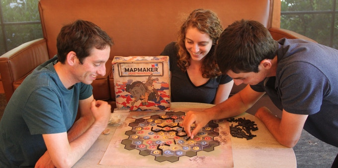 Josh Lafair playing Mapmaker: the Gerrymandering game with his brother and sister.