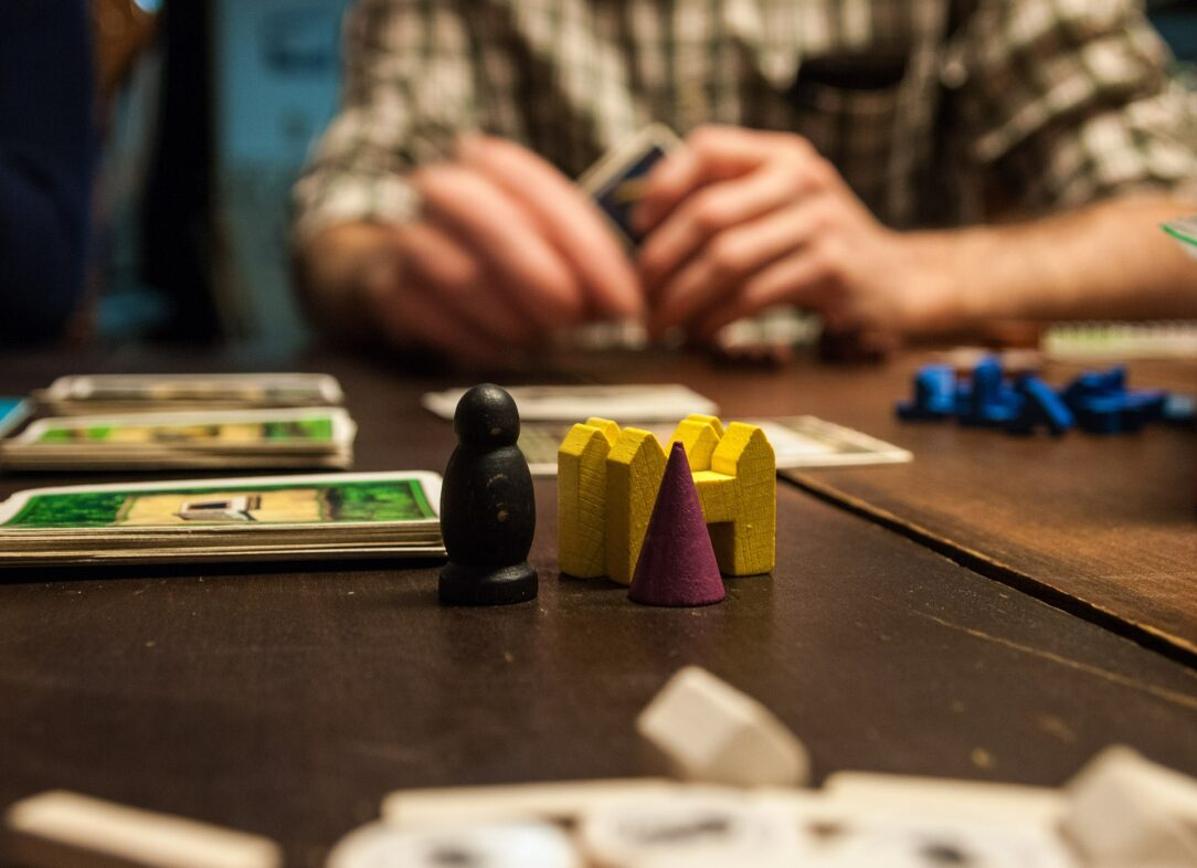 Close up on game pieces in a card game, like Politicraft, a civic action card game.